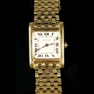 A Gold Cartier Tank Wristwatch, 1920's sold for $10,000.