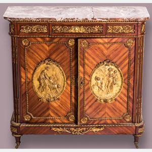 A Louis XVI Style Tulipwood Cabinet with Rouge Marble Top and Ormolu Mounts by Befort Jeune (Mathieu Befort, 1813-1880). Sold $10,000