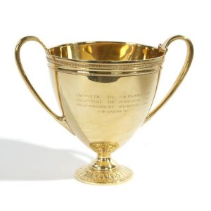 A Tiffany & Co. 18kt Yellow Gold Double Handle Presentation Cup, 20th Century sold $17,000