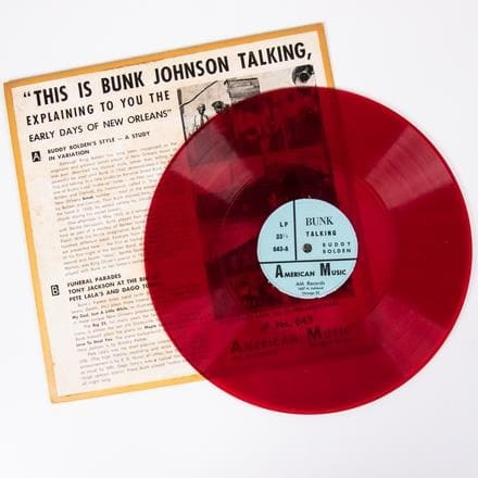 BUNK JOHNSON RED 10 IN. VINYL LP   A Bunk Johnson Red 10 in. Vinyl LP from American Music Records, 20th Century, Titled: 'This Is Bunk Johnson Talking, Explaining to You the Early Days of New Orleans' (American Music LP No. 643, red vinyl plastic record).   Est: $80 - $120