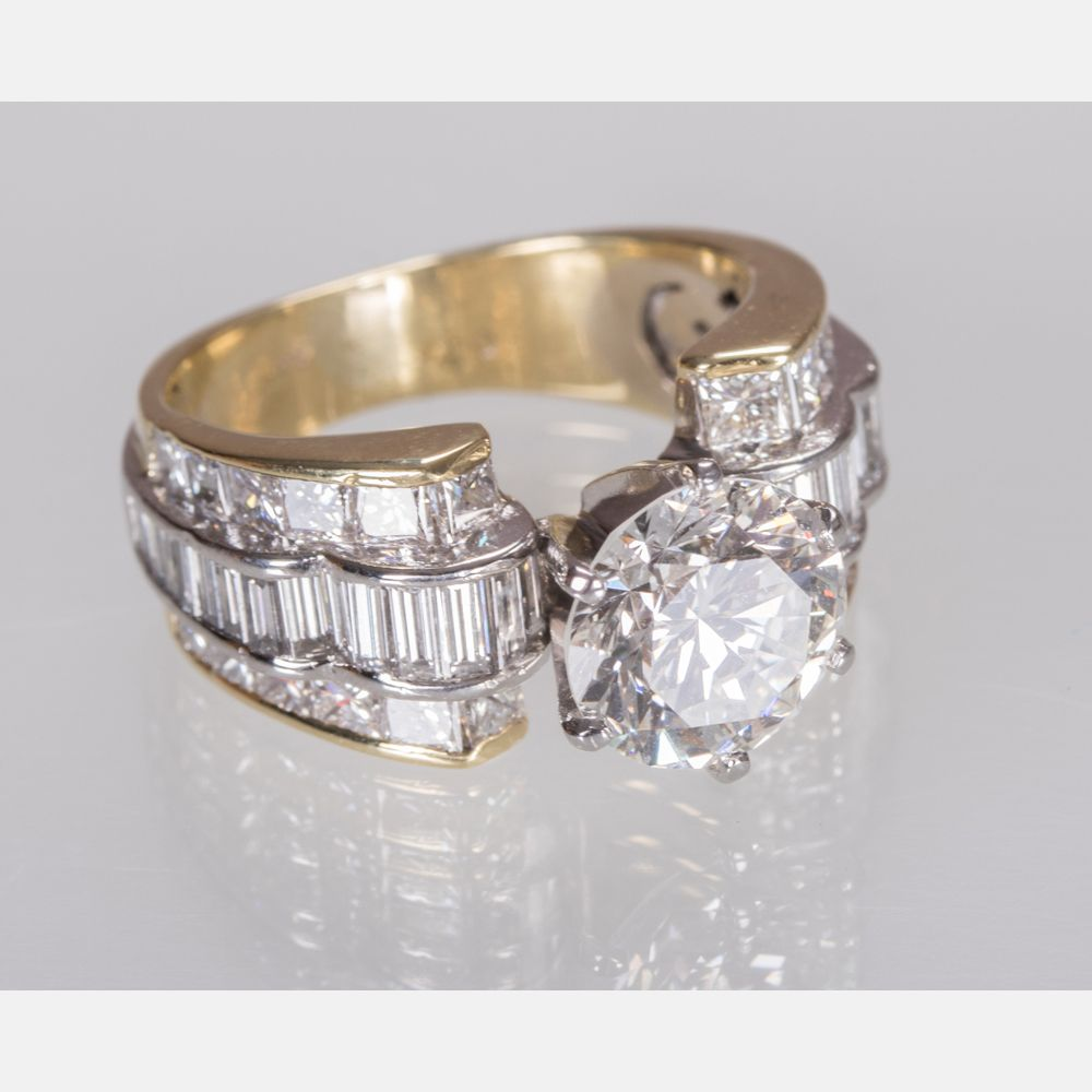 An 18kt. Yellow Gold and Platinum Diamond Ring, sold $10,000