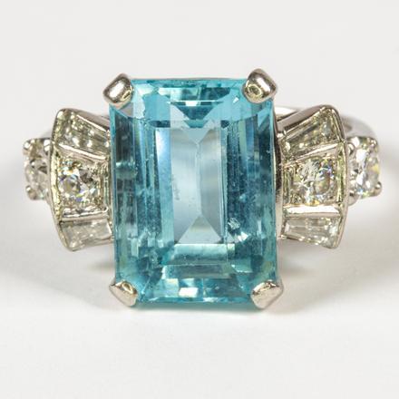 PLATINUM, AQUAMARINE AND DIAMOND RING.  Estimate:  $2,000 - $4,000.    View lot >