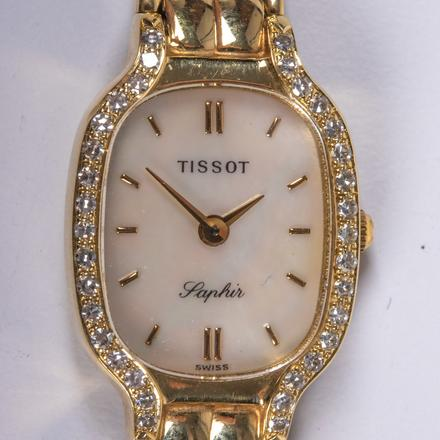 A TISSOT GOLD AND DIAMOND WATCH.  Estimate:  $800 - $1,200.    View Lot >
