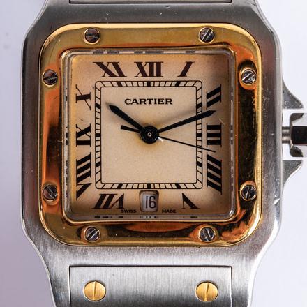 CARTIER SANTOS BI-METAL QUARTZ WRIST WATCH.  Estimate:  $800 - $1,200.    View Lot >