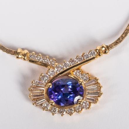 YELLOW GOLD AND TANZANITE NECKLACE.  Estimate:  $1,000 - $2,000.    View Lot >