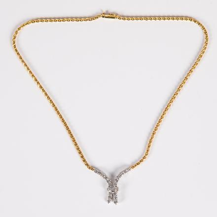 WHITE/YELLOW GOLD, DIAMOND NECKLACE.  Estimate:  $2,000 - $3,000.    View Lot >