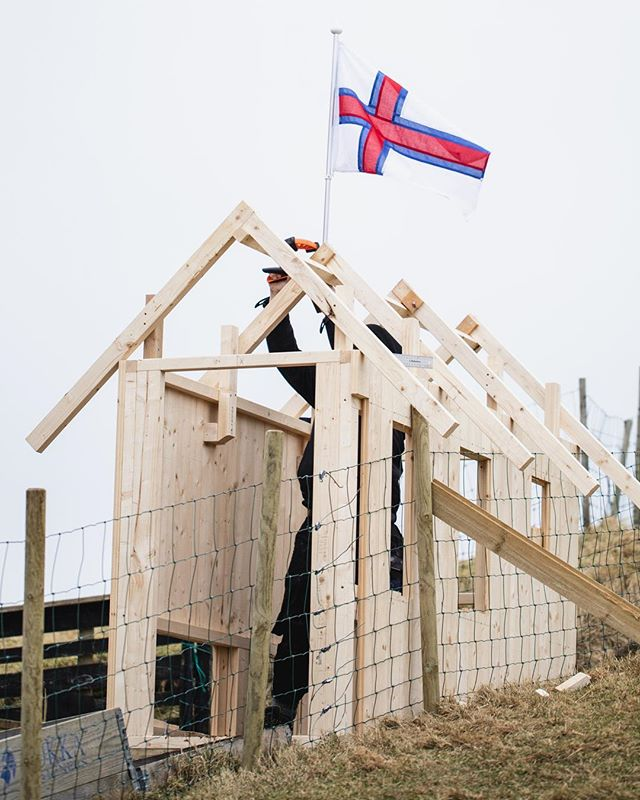 New chicken coop in the making curtesy of Mr. Hanusarstova @avgordum 🙌🏻⁣⠀ ⁣⠀ Here in The Faroe Islands it is tradition to put the Faroese flag up when you've raised the roof of a new house - so we did! I'm sure the chickens are going to love their new bigger house with an even bigger range area. Isn't it cool ?