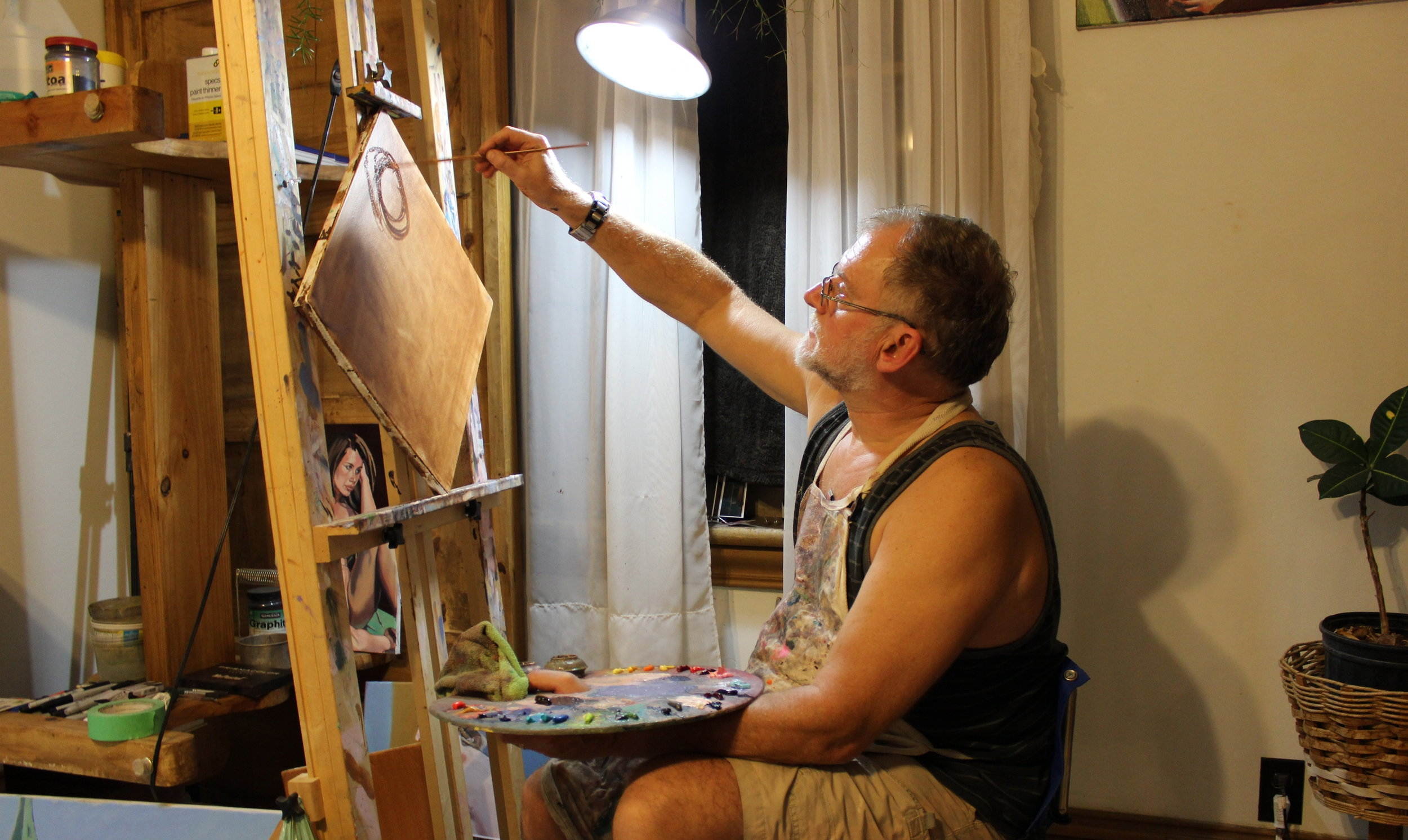 My dad, who runs the figure drawing with me, painting away.