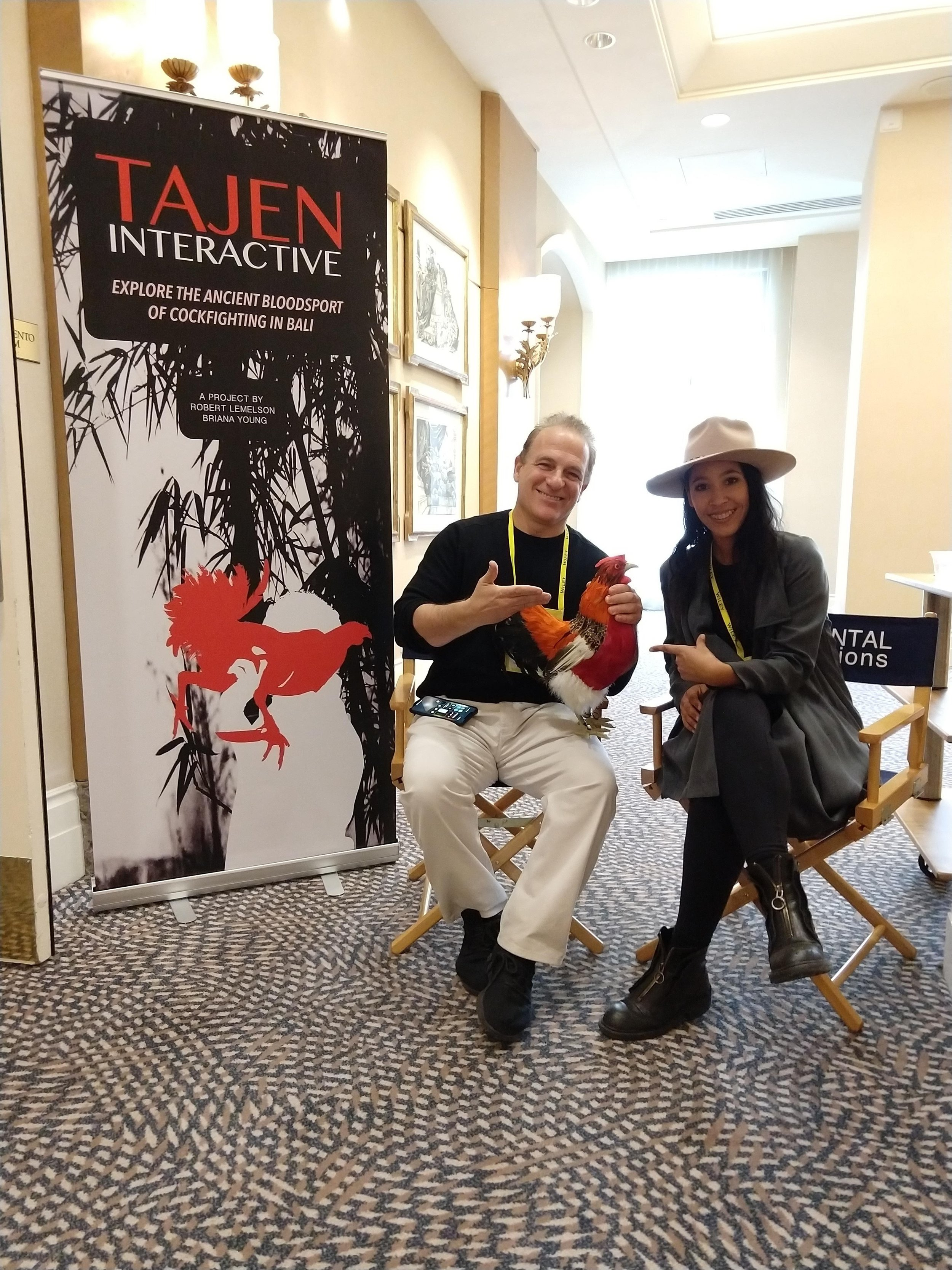 Director Robert Lemelson and co-director Briana Young at an installation of Tajen: Interactive at the 2018 Annual American Anthropologist Conference in November 2018 in San Jose, CA