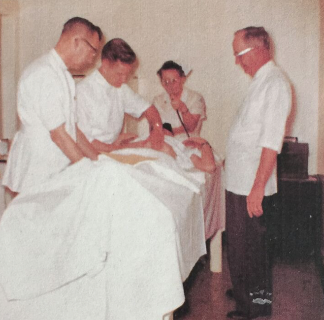 Picture of Dr. White (right) Dr. Jacob (middle) and Dr. Failor (left) performing an abdominal manual therapy at the Happy Acres Hospital in McMinnville, Oregon in the 1950s.