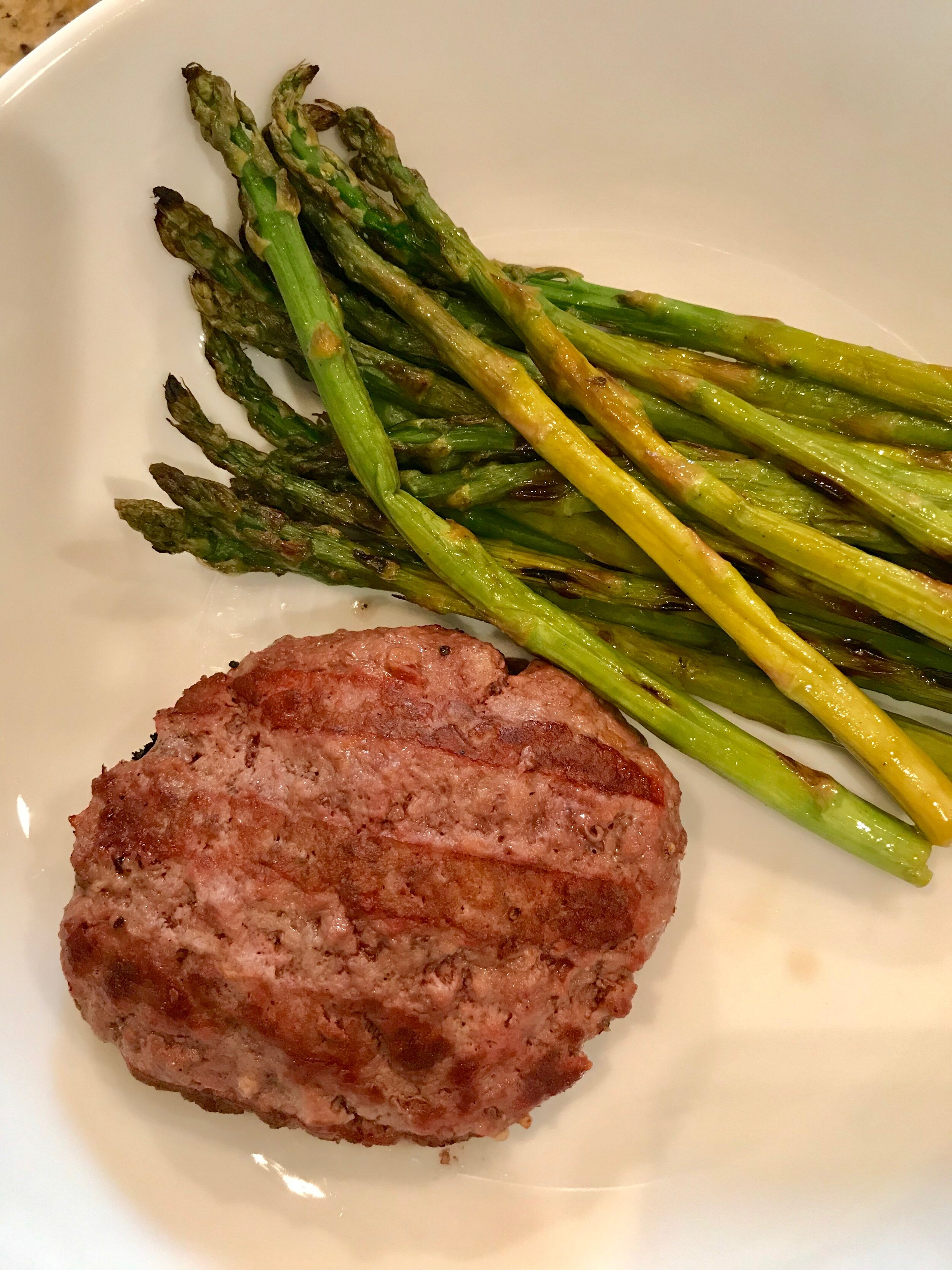 Broke my Fast - Grass-fed beef burger with asparagus. I added some Cava hummus as a healthy fat.