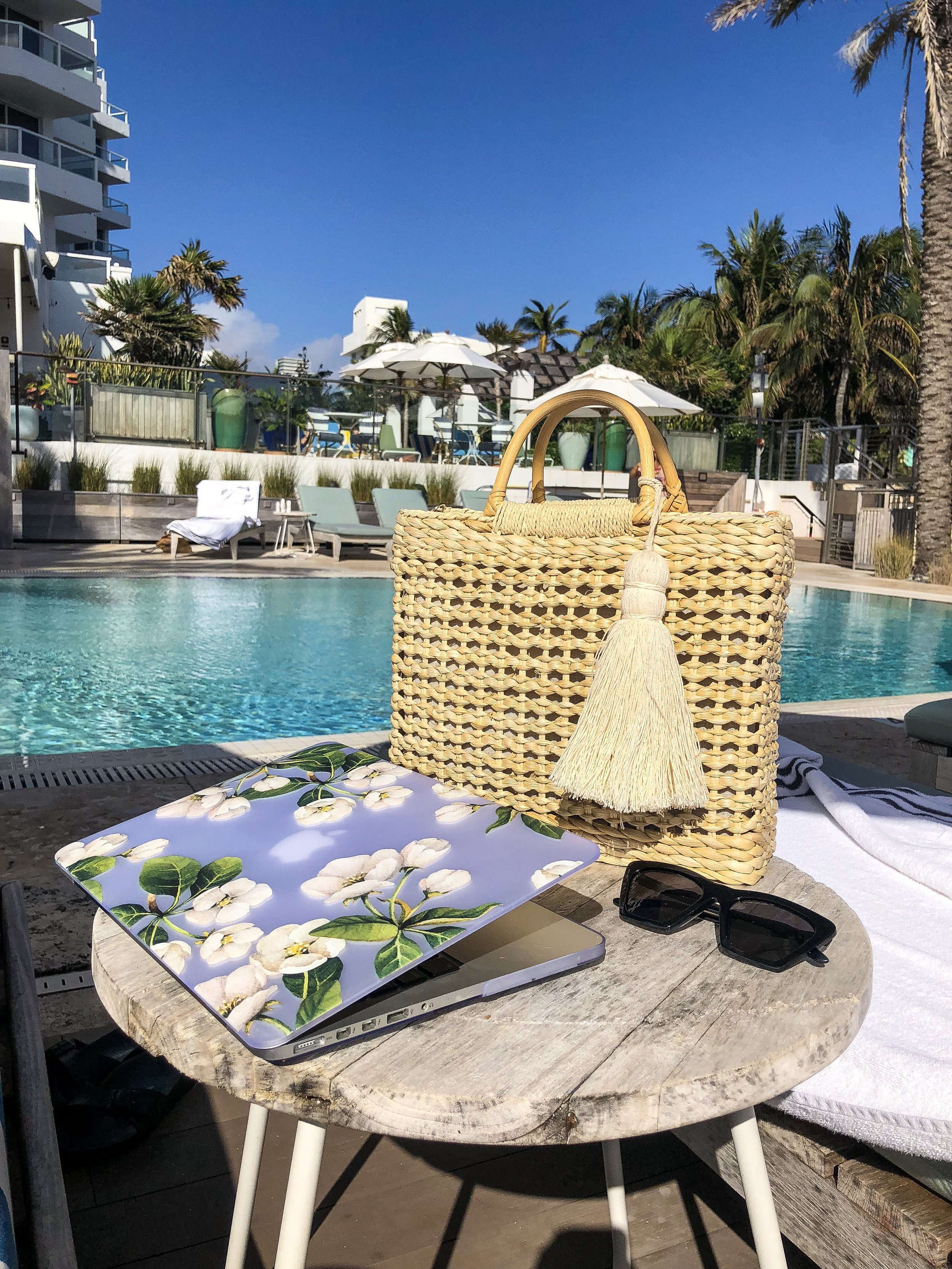 As I write this post, - I'm sitting underneath an umbrella that's protecting me from the Miami sun; trading in the desk inside our South Beach hotel room for a pool view and sea breeze.