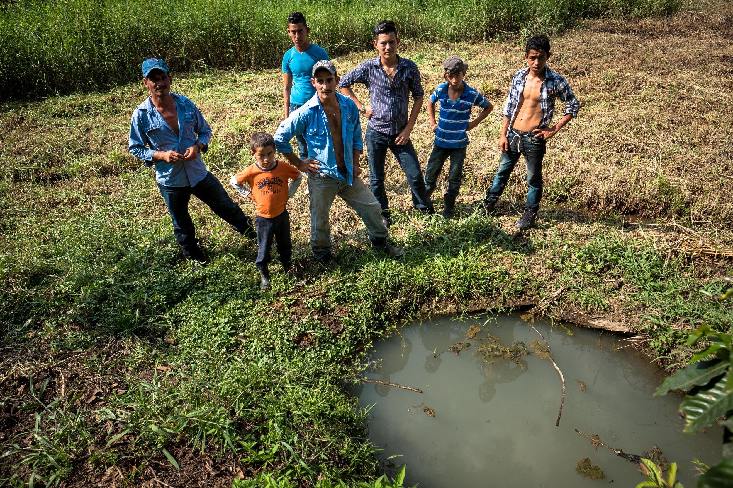 Honduras 18 day 2 men hole water.jpg