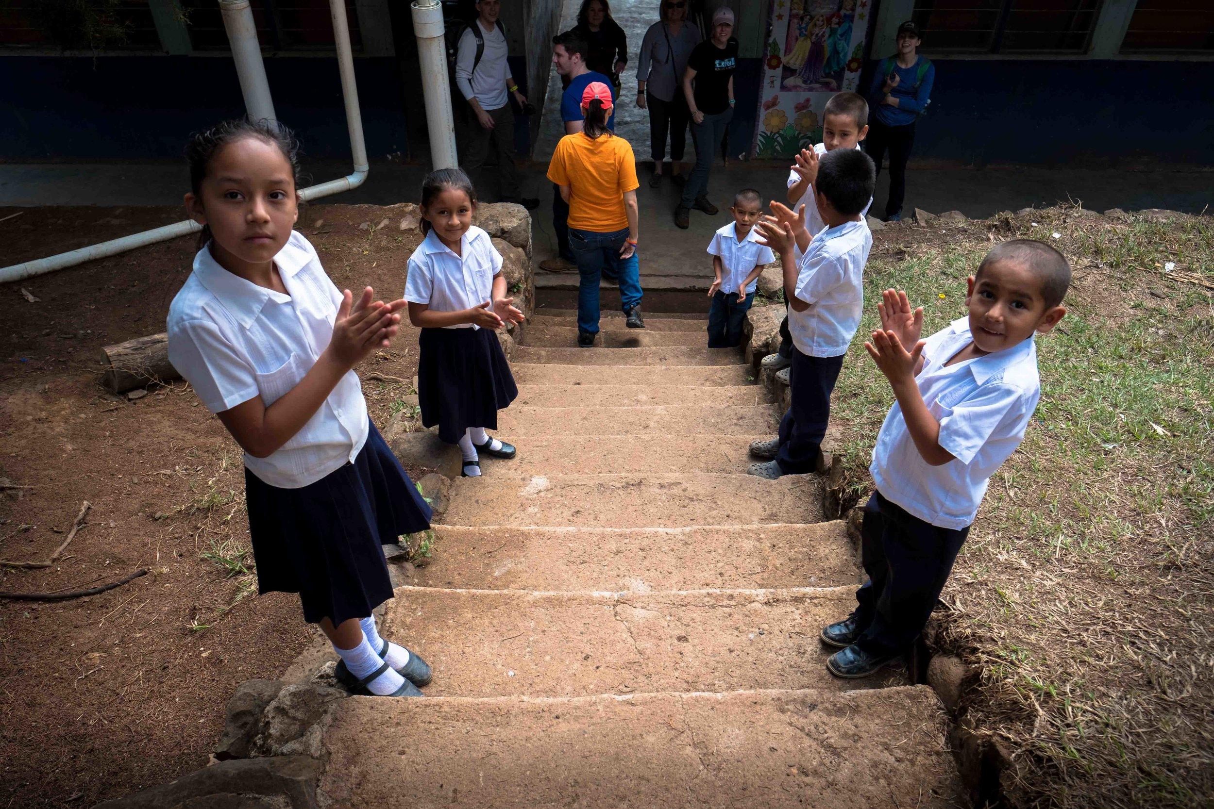 Honduras 18 day 2 welcome children clap.jpg