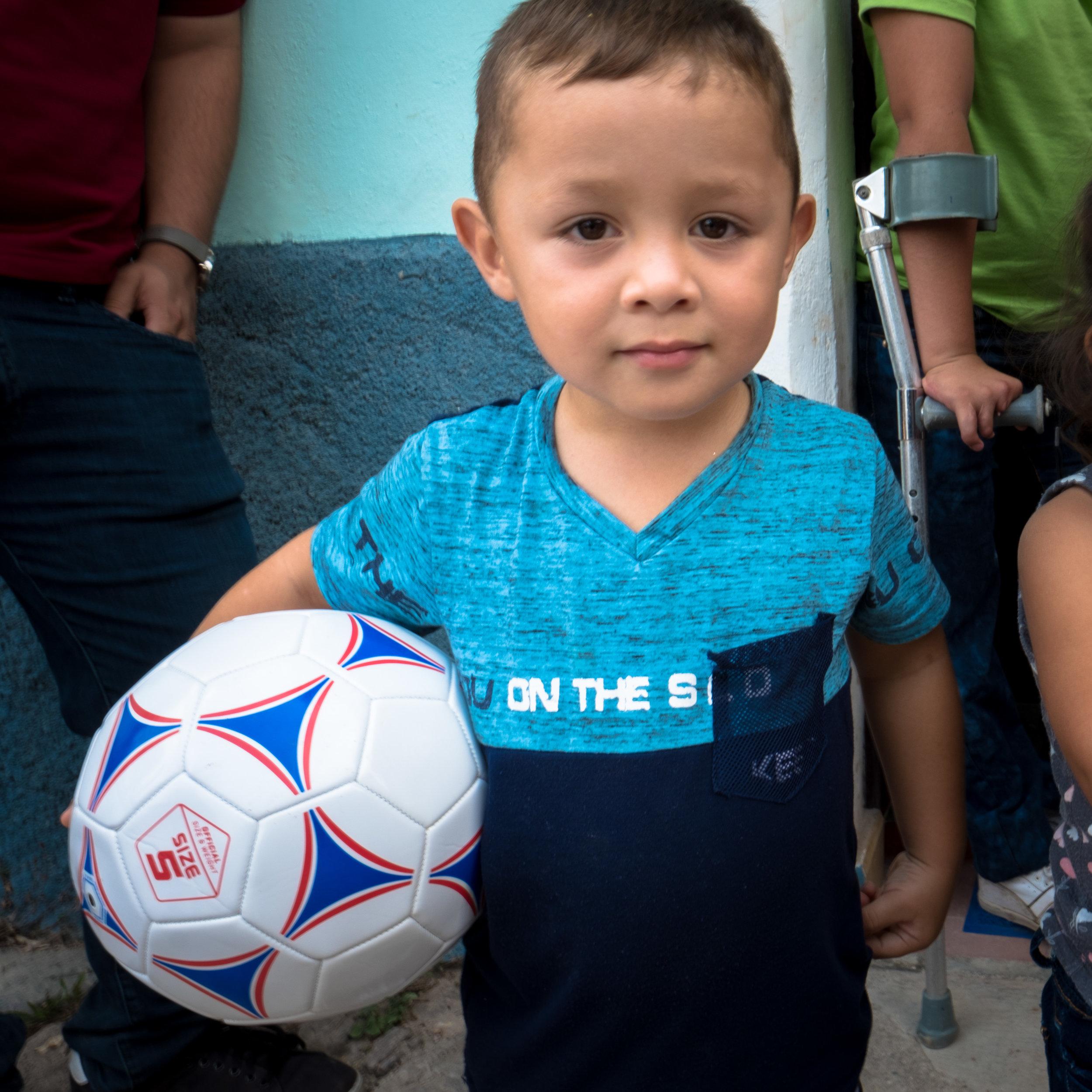 Honduras 18 day 2_lunch boy with ball.jpg