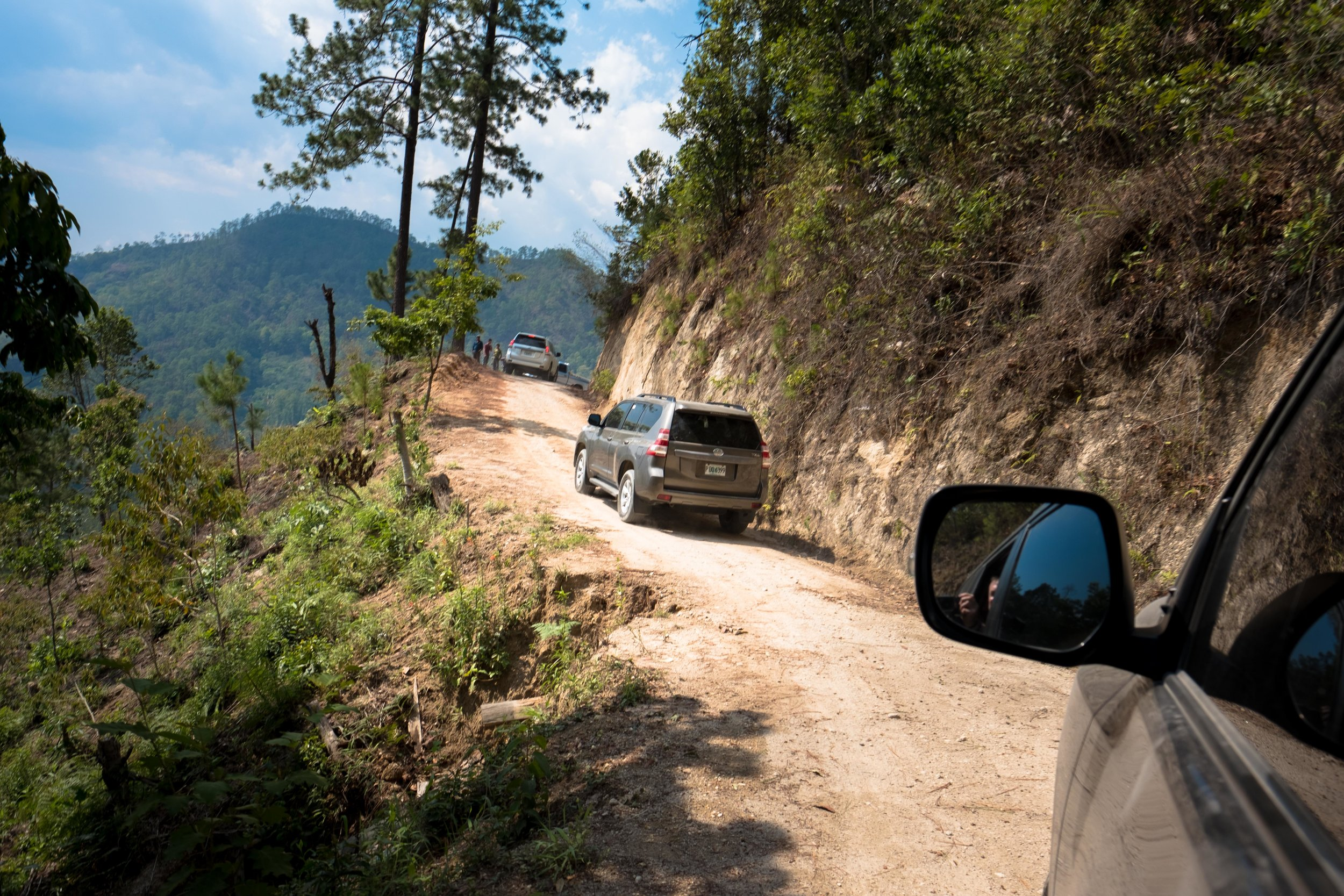 Honduras 18 day 2_SUVs on steep road 2.jpg