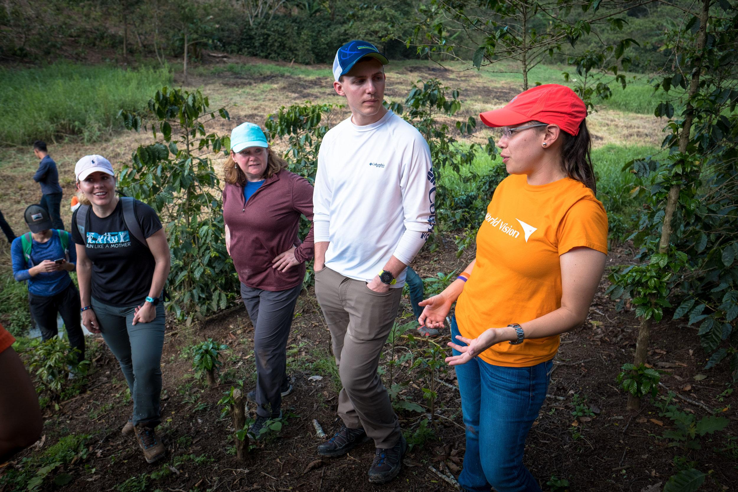 Honduras 18 day 2_team and Nadia talk by water hole.jpg