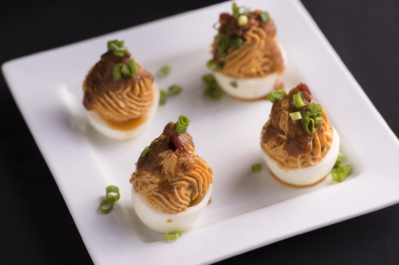 SPANISH DEVILED EGGS - bacon, smoked paprika, green onion, habanero salsa