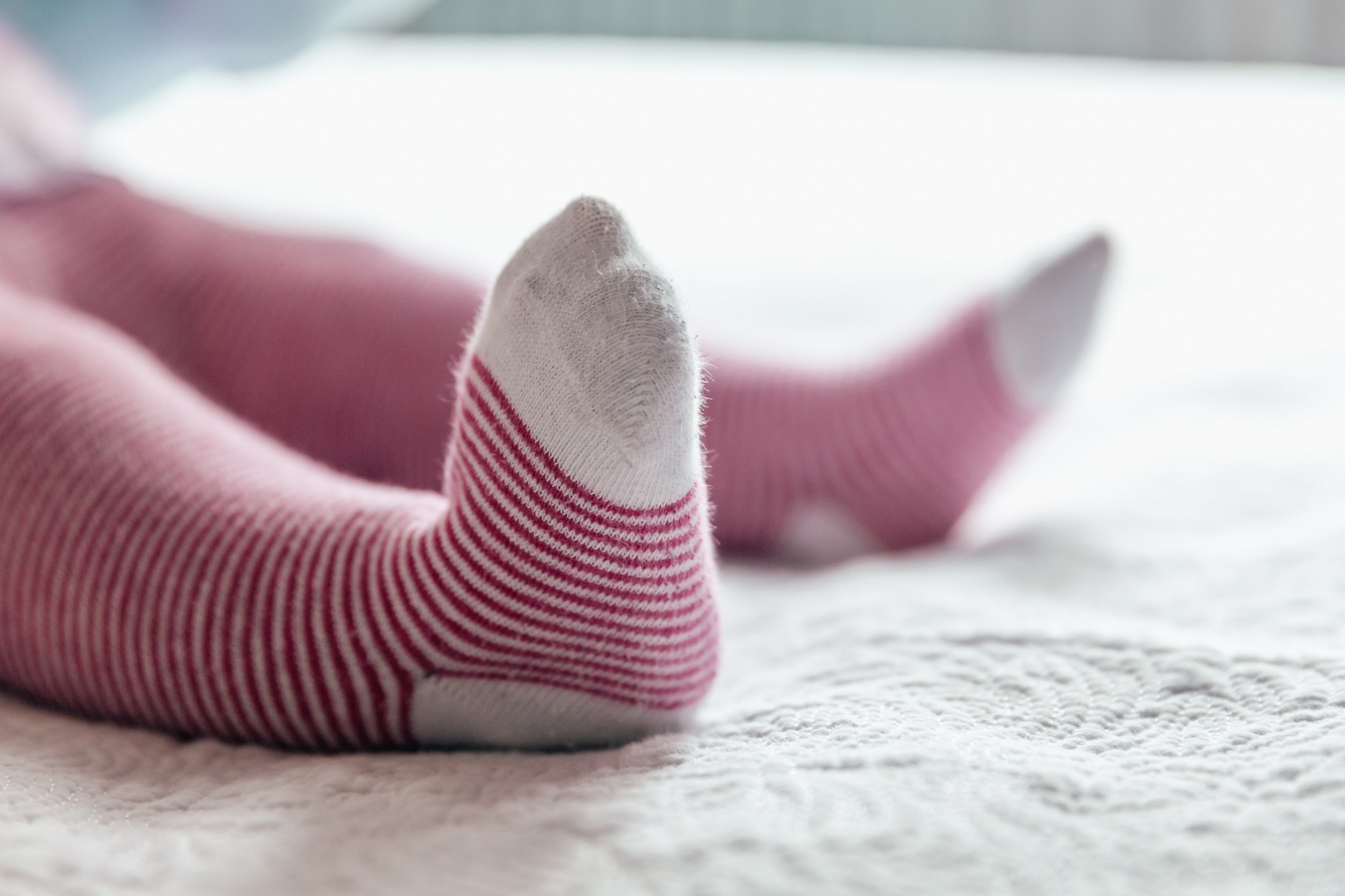 baby-feet-in-striped-socks_4460x4460.jpg