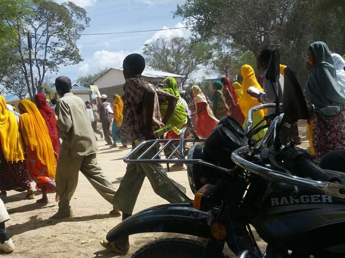 "Ngwatilo Mawiyoo, ""Off to a political rally, 2013""."