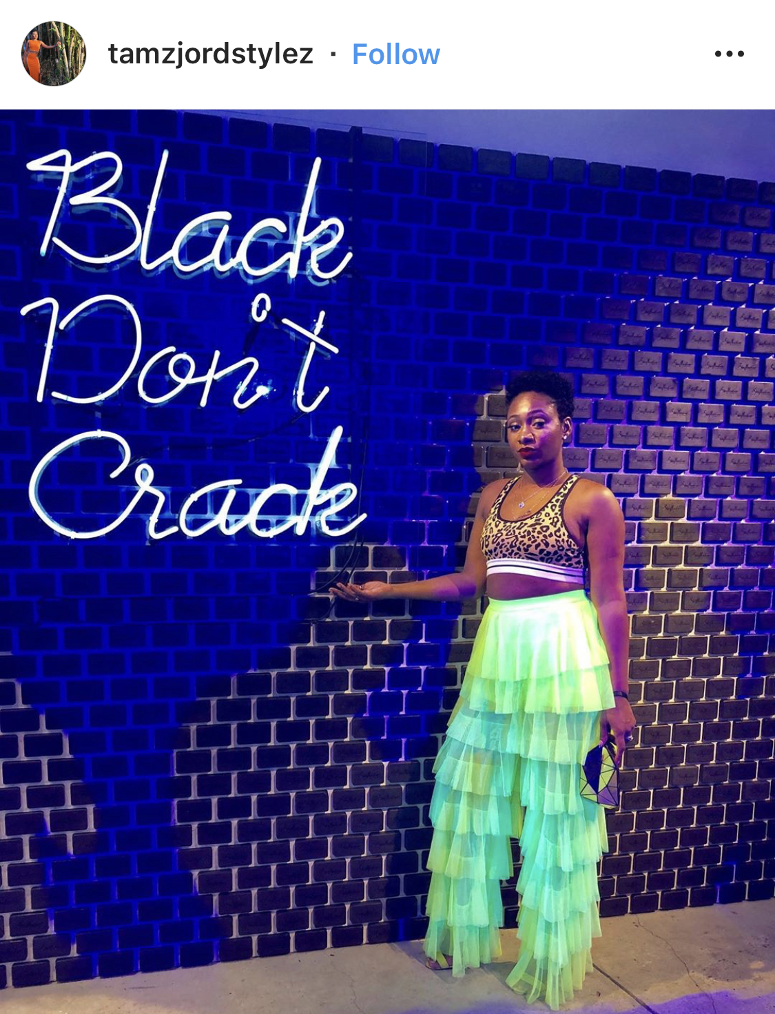 "Another example of a simple but beautiful brand activation. It is difficult to see the words on the tile (which looks like black soap, not sure what brand) but the ""Black Don't Crack"" neon lights were PERFECT for Essence Fest."