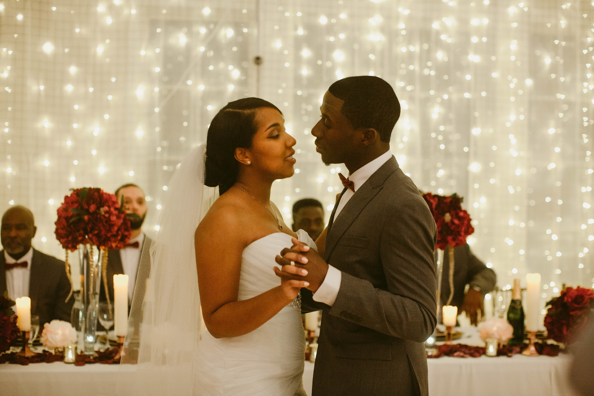 Joshua & Kiara Donald - When I hired Jennifer, I never would have expected the amount of dedication, attention to detail, the support, not only to me but to my family and wedding party, and her complete devotion to making my wedding day special. She was always poised, confident, diligent which not only saved me monetarily on numerous occasion but it helped put my family at ease. Now to the reception, it was everything I wanted and more. It was a dream! My husband and I couldn't believe how she was able to transform an empty hall into a romantic space. That night, I danced to twinkling lights in what can only be described as every little girl's dream. I never had a concrete vision of what I wanted but Jennifer took my ideas and made it a reality. As I look back on those pictures, I am in awe because there was no small effort made to create that day and make it what it was. Jennifer is incredible in what she does.