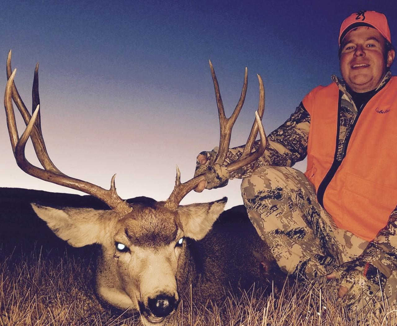Travis C and his nice mule deer buck.jpg