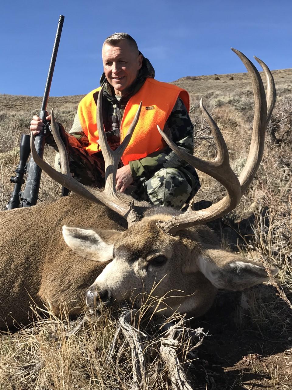 Gerry H and his trophy Colorado mule deer buck.jpg