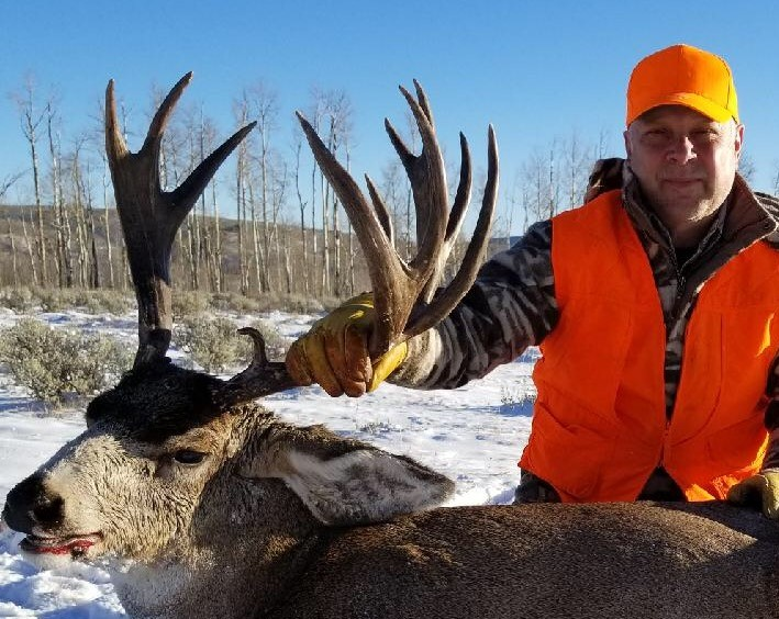 Jim Bic and his massive non typical mule deer buck.jpg
