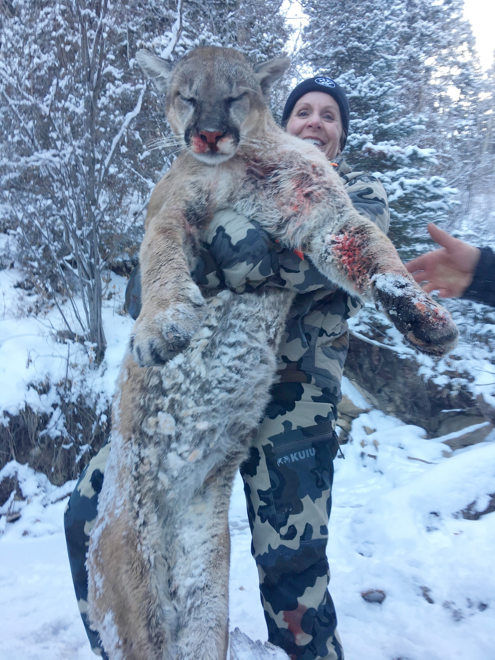 Susan with her trophy tom mountain lion.JPG