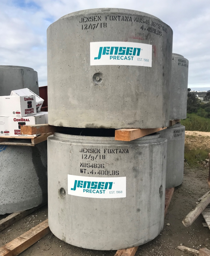 A single deep sump tank from Jensen Precast has a 200-gallon capacity, weighs 4400 pounds, and must be lowered into place by a crane.