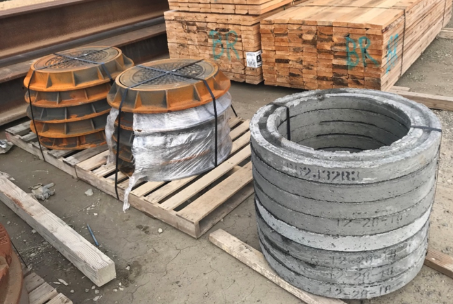 After the precast basin is installed as the sump tank, a cone and rings will be placed on top, bringing the unit to ground level. A metal lid will then be added and the sump tank will appear as a manhole.