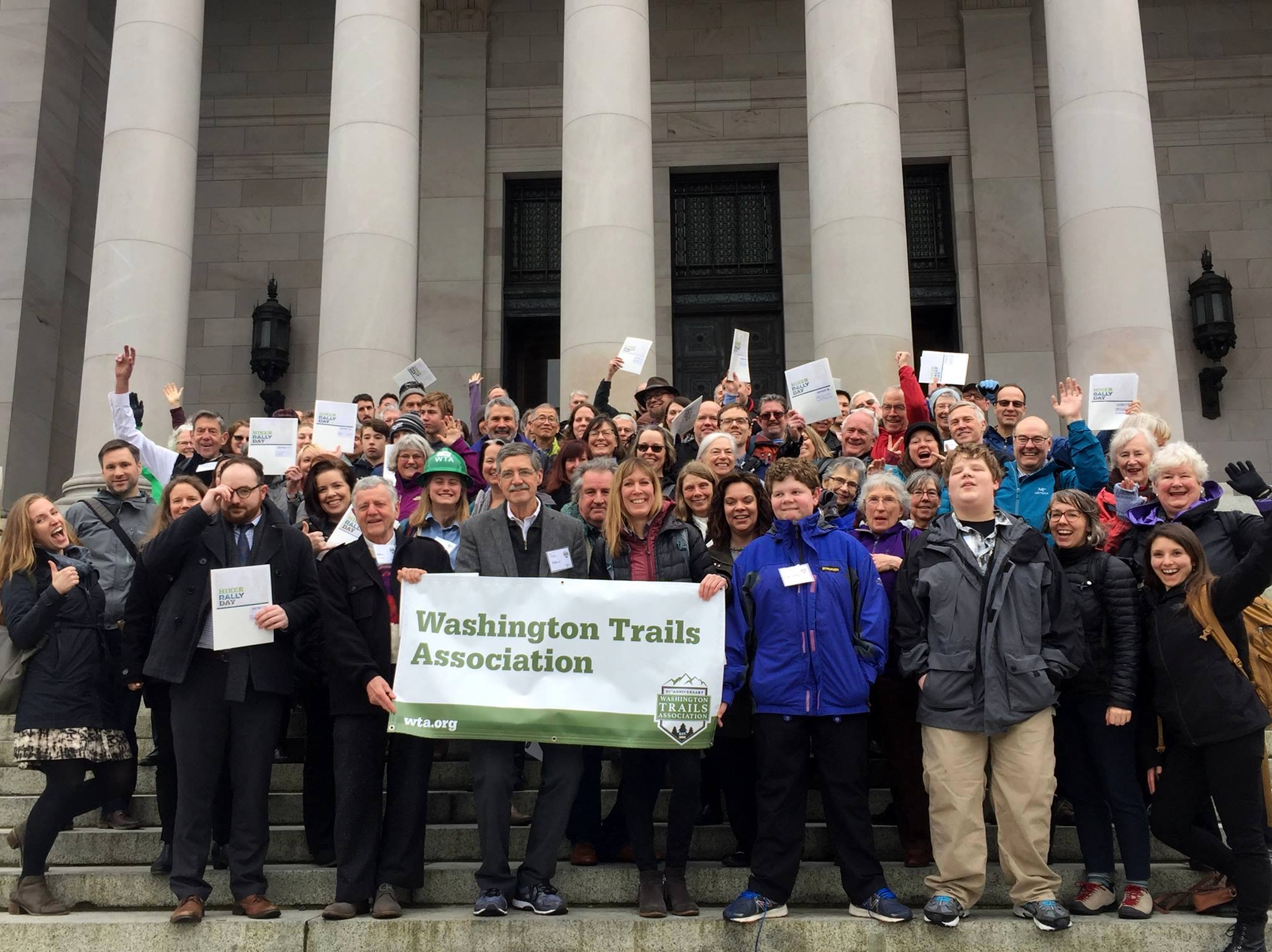 Group photo of WTA trail and public land advocates on the steps of the capitol building in Olympia.