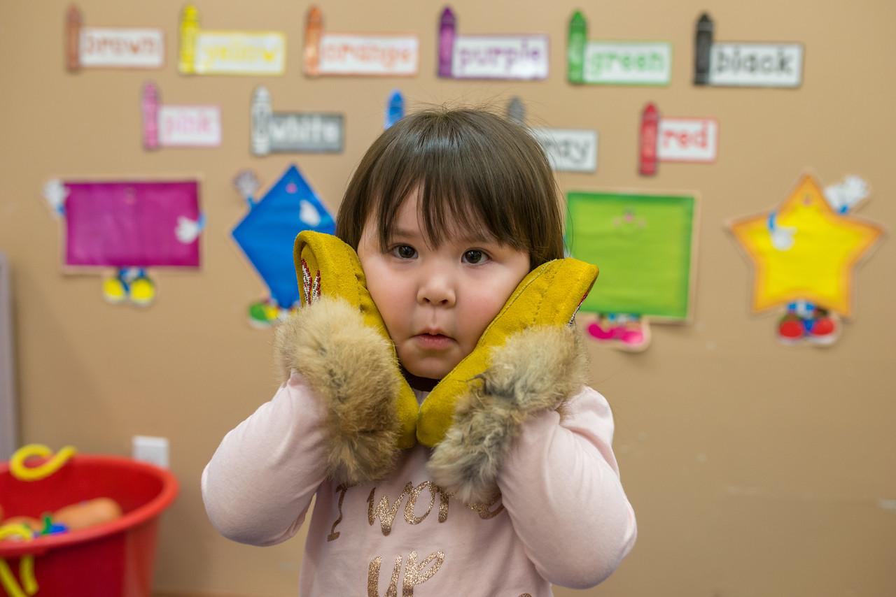 child holding mocassins.jpg