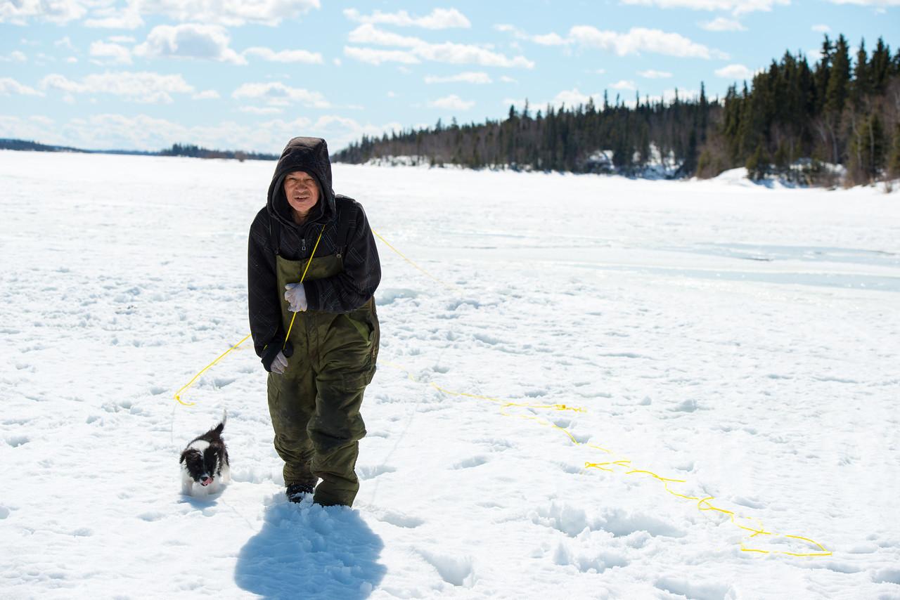 MAN ON ICE WITH PUPPY.jpg