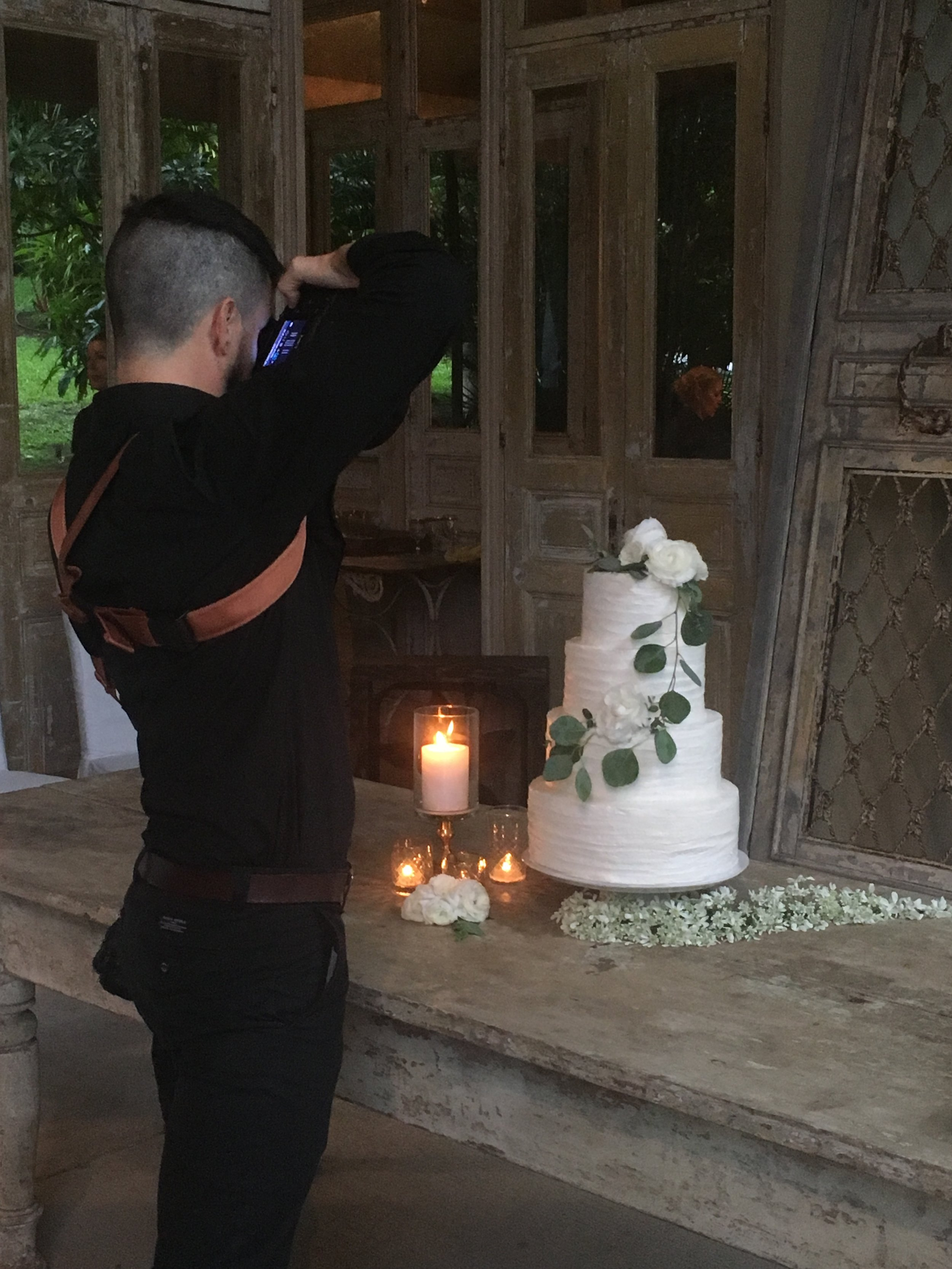Simple and elegant wedding cake with subtle texture and fresh gardenia