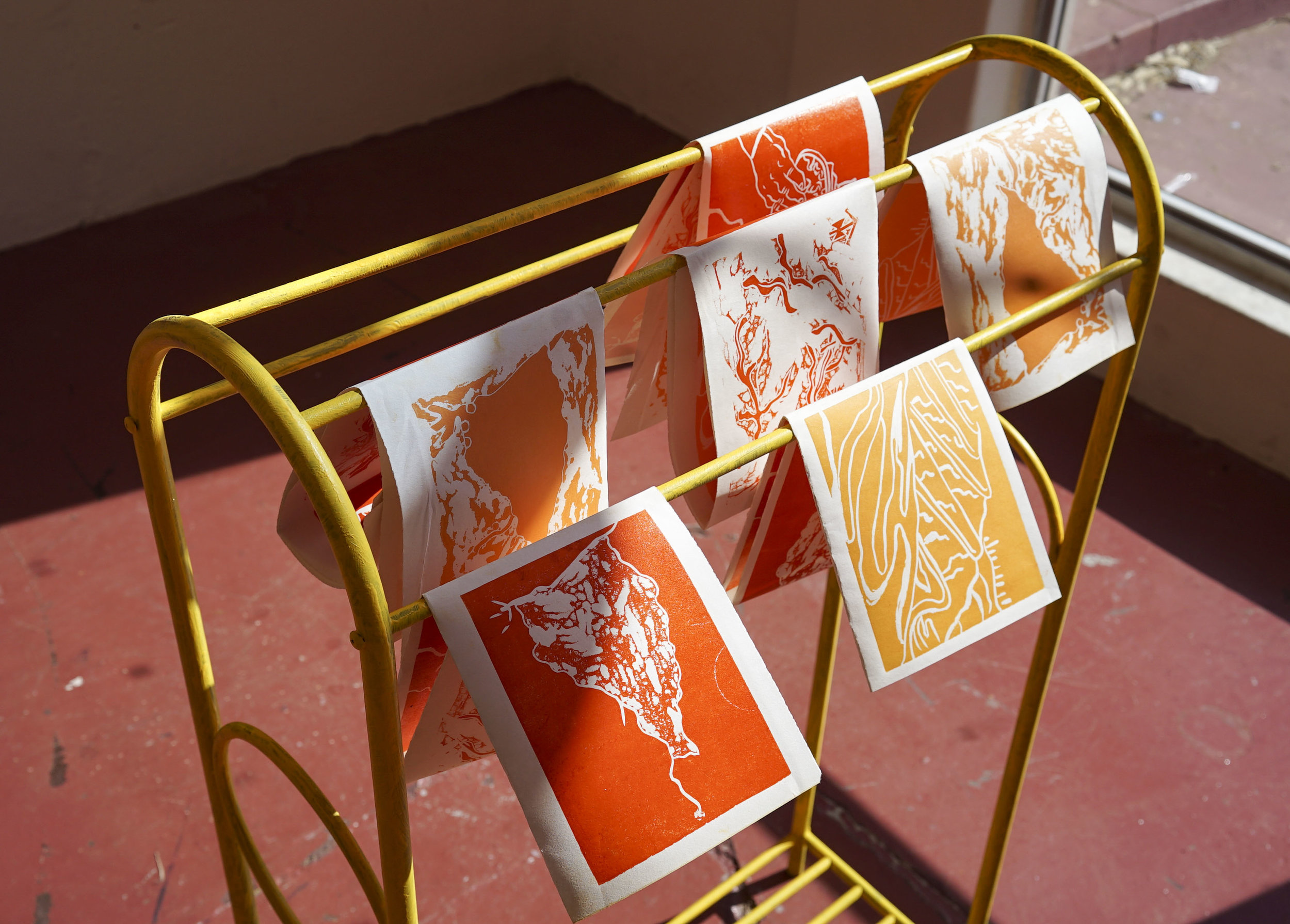 Press Check - Phoebe BeardFor the love of gold, lino cut on paper, towel rack and acrylic paint, 170 x 140mm (folded) 500 x 280mm (flat)