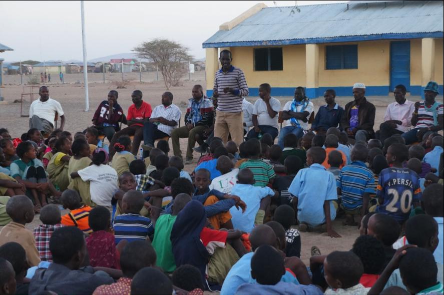 NRT education officer Julius Lolkinyati talking to pupils about conservation, personal development and good teamwork
