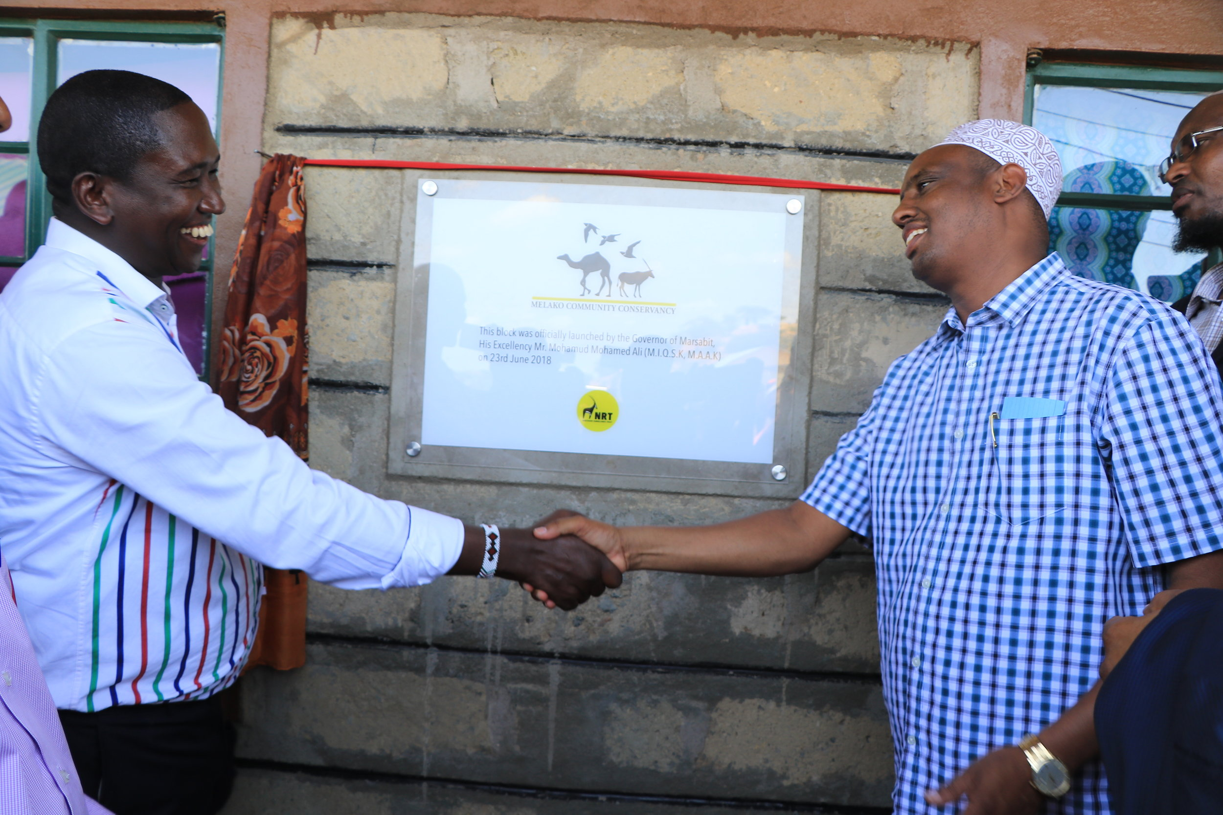 NRT CEO Tom Lalampaa with Marsabit County Governor H.E Mohamud Mohamed Ali at the opening of the Merille School teacher's block