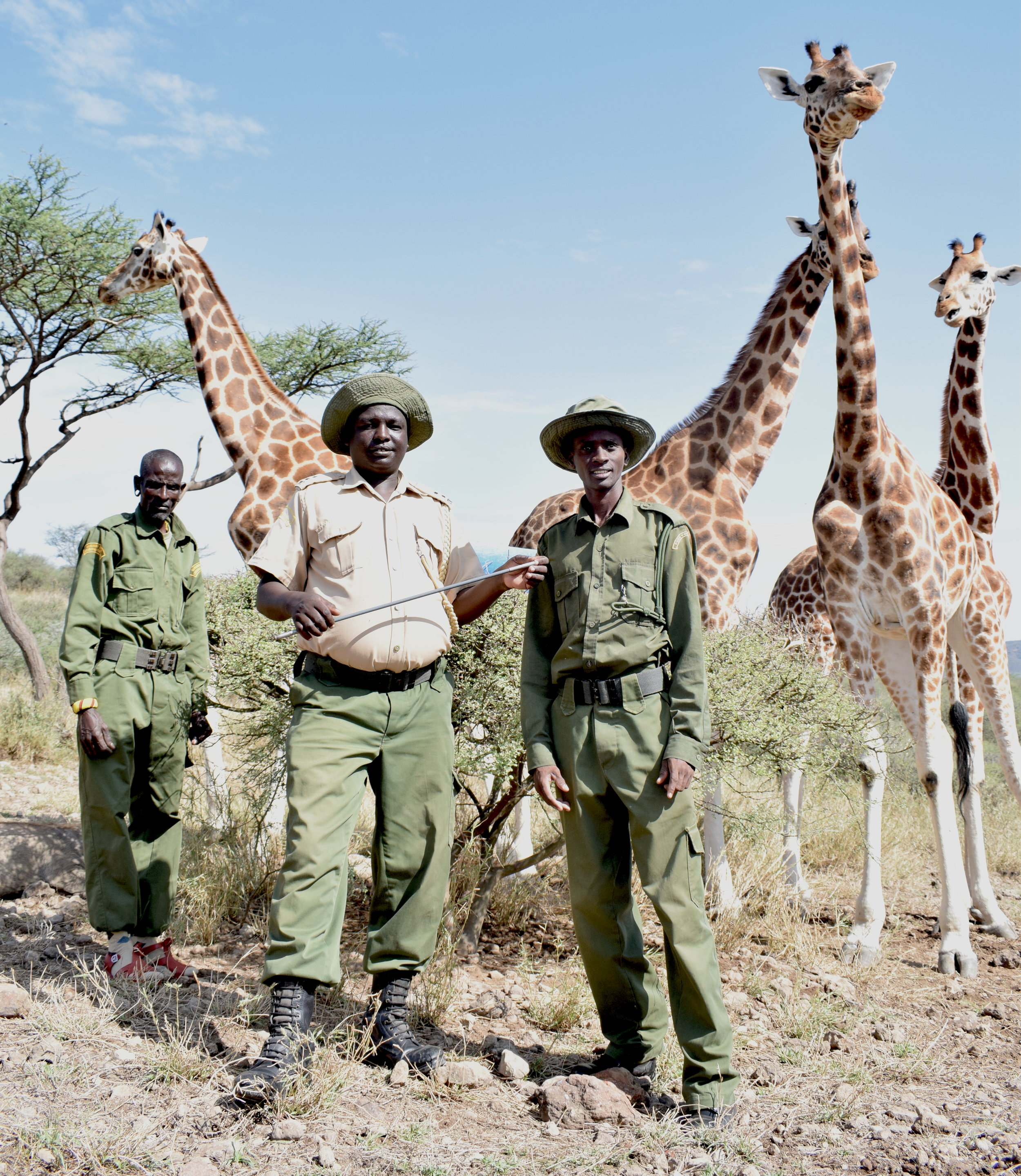 Foreground: Conservancy Warden James Cheptulel, left, and ranger Michael Parkei (right). Photo: Ivy Wairimu