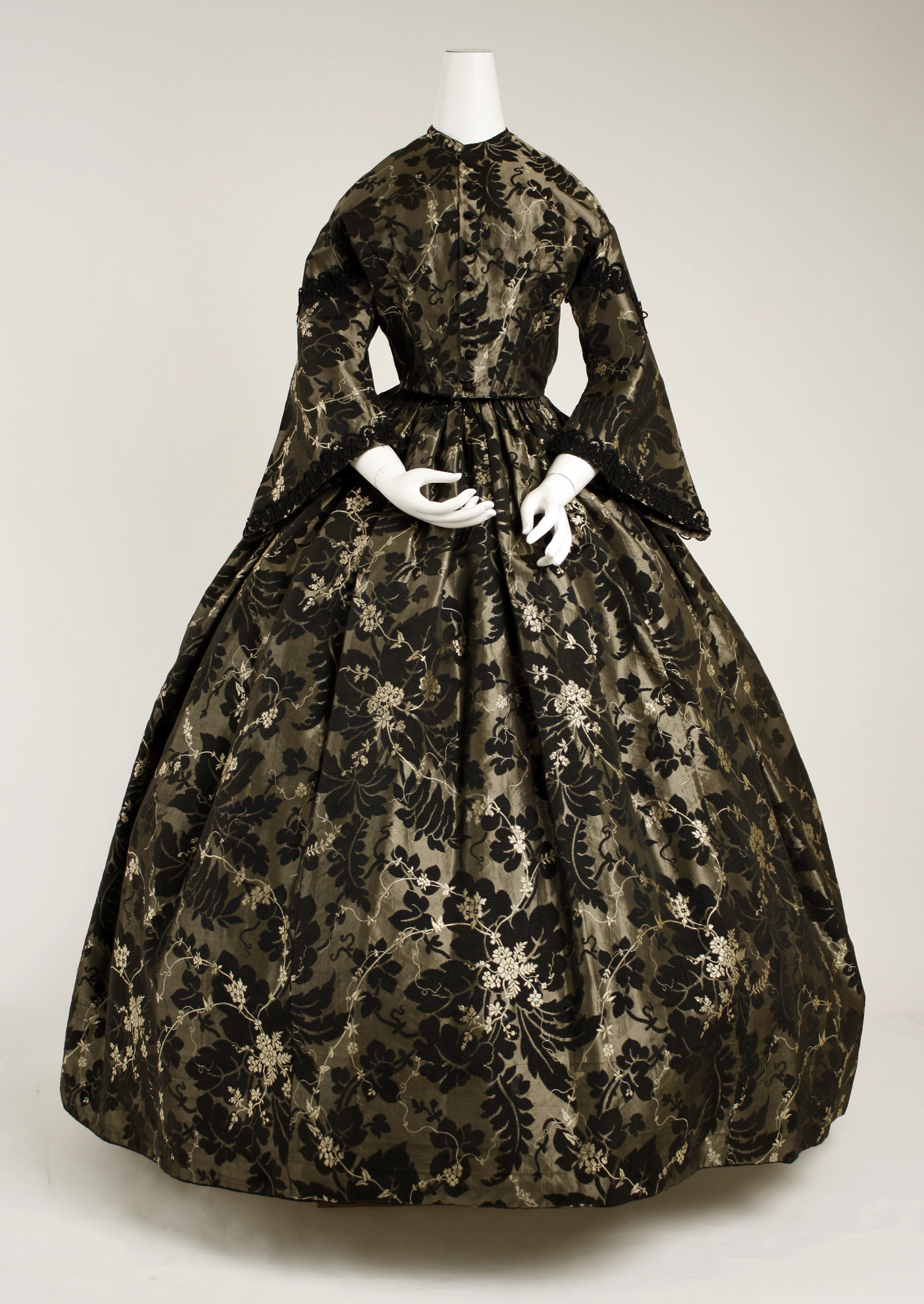 This 1850s evening gown is so very pretty, made for someone who isn't keen to show off their décolletage.   Courtesy the Metropolitan Museum of Art, Gift of Mrs. Frederick Street Hoppin, 1963.