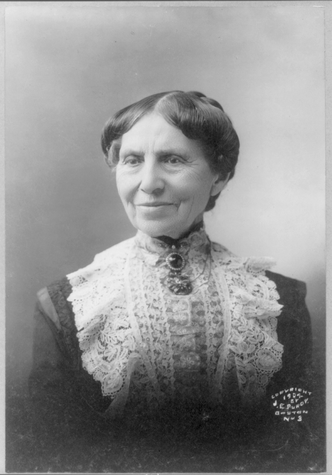 Clara in 1904, still dying her hair so people will think she's younger than she is. I think this had less to do with vanity than with having people take her seriously. She was out in foreign countries - in war zones, sitting around campfires - into her seventies. Girl was never very good at sitting still.   Courtesy of Clara Barton National Historic Site/National Park Service.