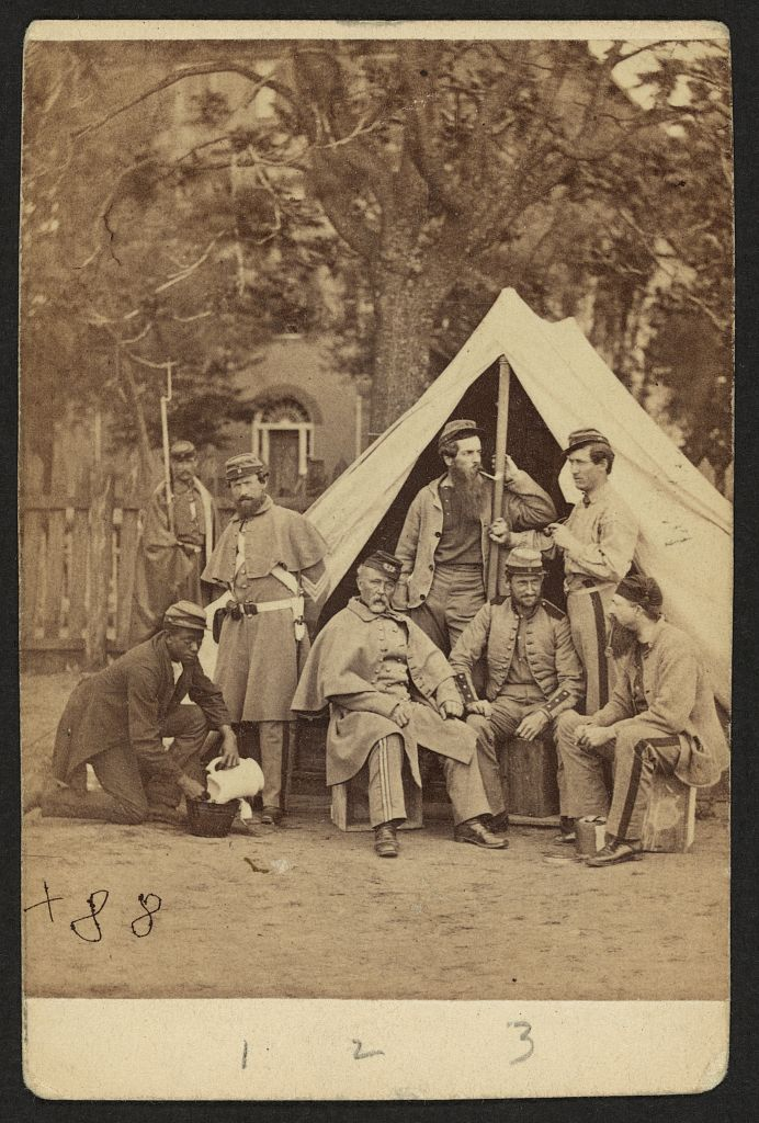 Group portrait of soldiers in front of a tent, possibly at Camp Cameron, Washington, D.C. Courtesy of the LOC.