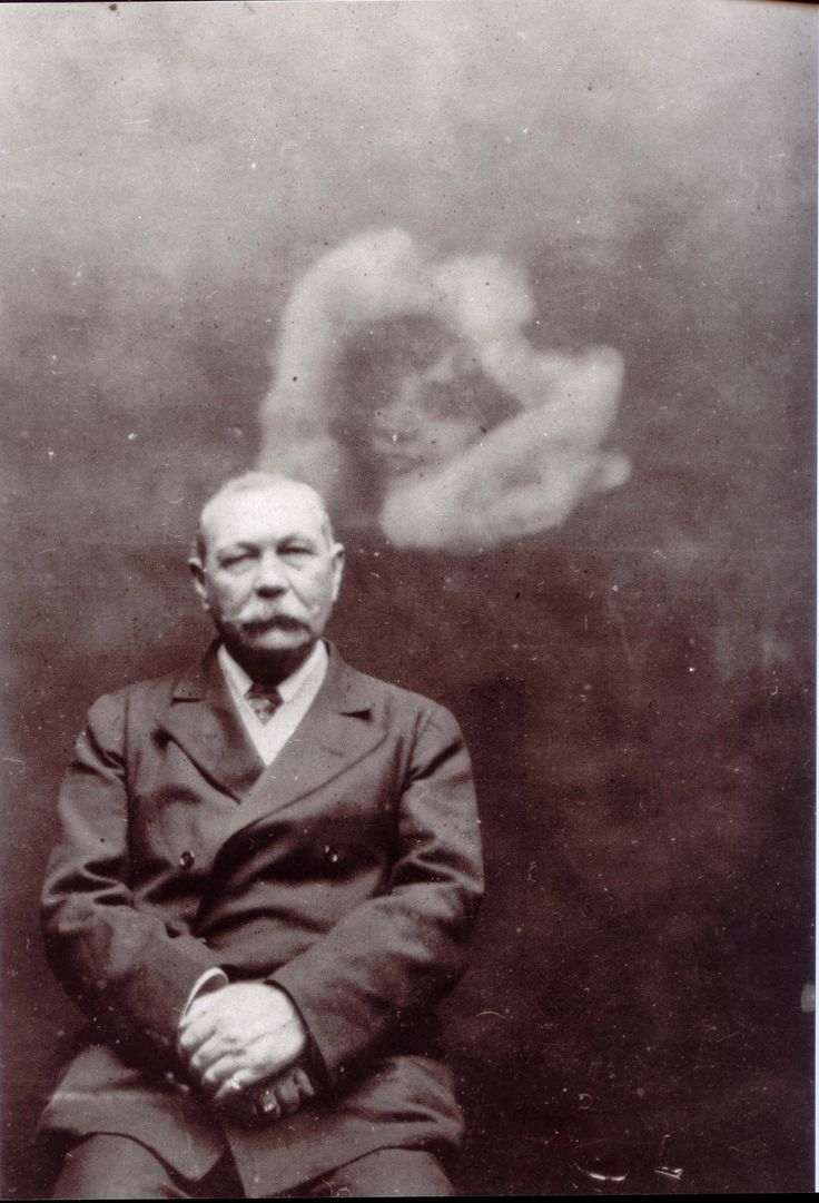 Arthur Conan Doyle, the guy who created Sherlock Holmes, was madly in love with Spiritualism. He believed in it all. Here he is with a spirit, making a sweet little face behind him.   Wikicommons