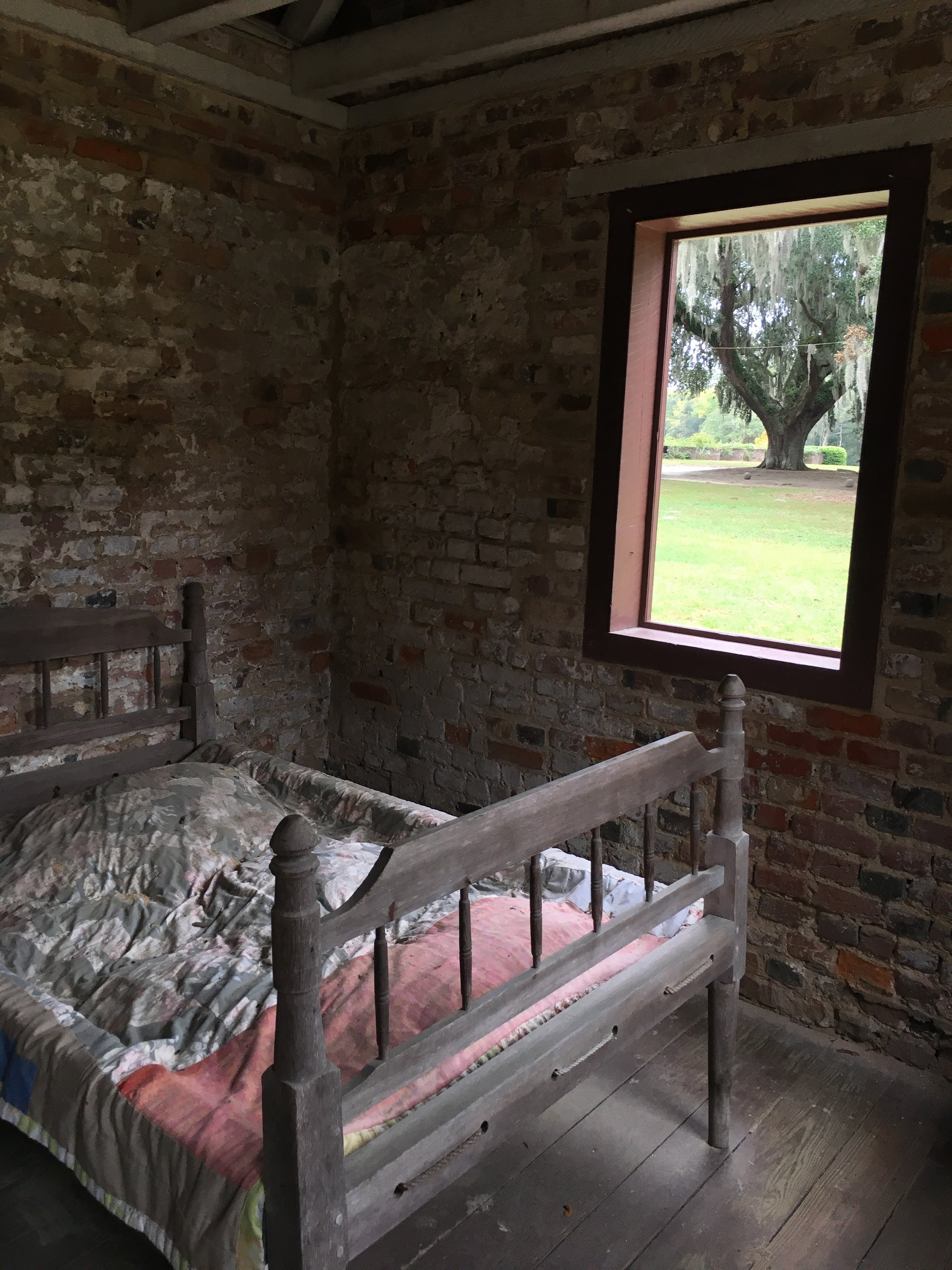 A haunting scene in a slave cabin at Boone Hall Plantation. Many people would have slept on pallets on the floor.