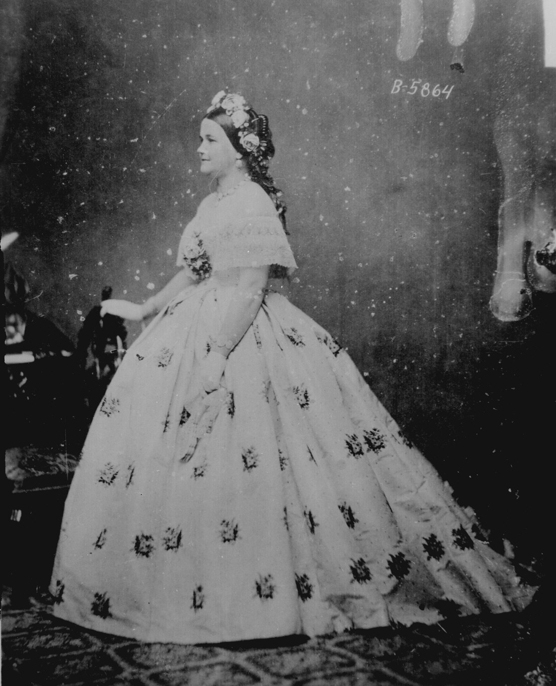 Mary Lincoln, with flowers in her hair and looking pretty AMAZING. Elizabeth Keckley would have helped pick out the fabrics and done some of this sewing work by hand.   Courtesy of the National Archives.