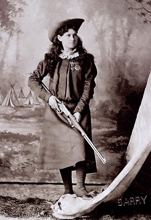 Annie Oakley showing off her shootin' skills. Courtesy of the National Portrait Gallery, Smithsonian Institution