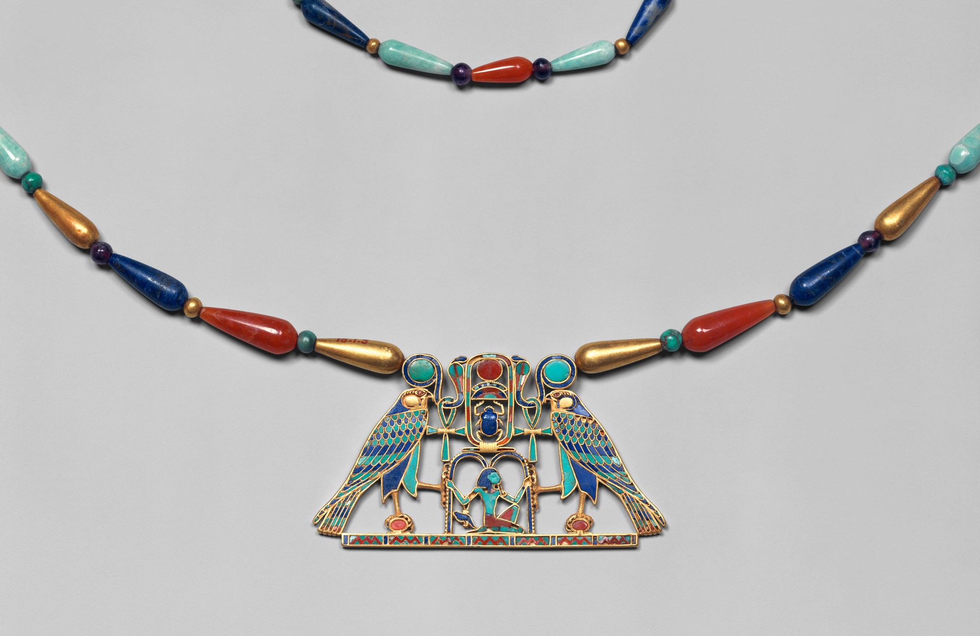 "This necklace was found among the jewelry of Princess Sithathoryunet. Hieroglyphic signs make up the design, which reads: ""The god of the rising sun grants life and dominion over all that the sun encircles for one million one hundred thousand years [i.e., eternity] to King Khakheperre [Senwosret II]."" Jewelry worn by royal women during the Middle Kingdom was about adornment, status, and firming up concepts about Egyptian royalty, capable of giving them  superhuman powers.   Courtesy of the Metropolitan Museum of Art"