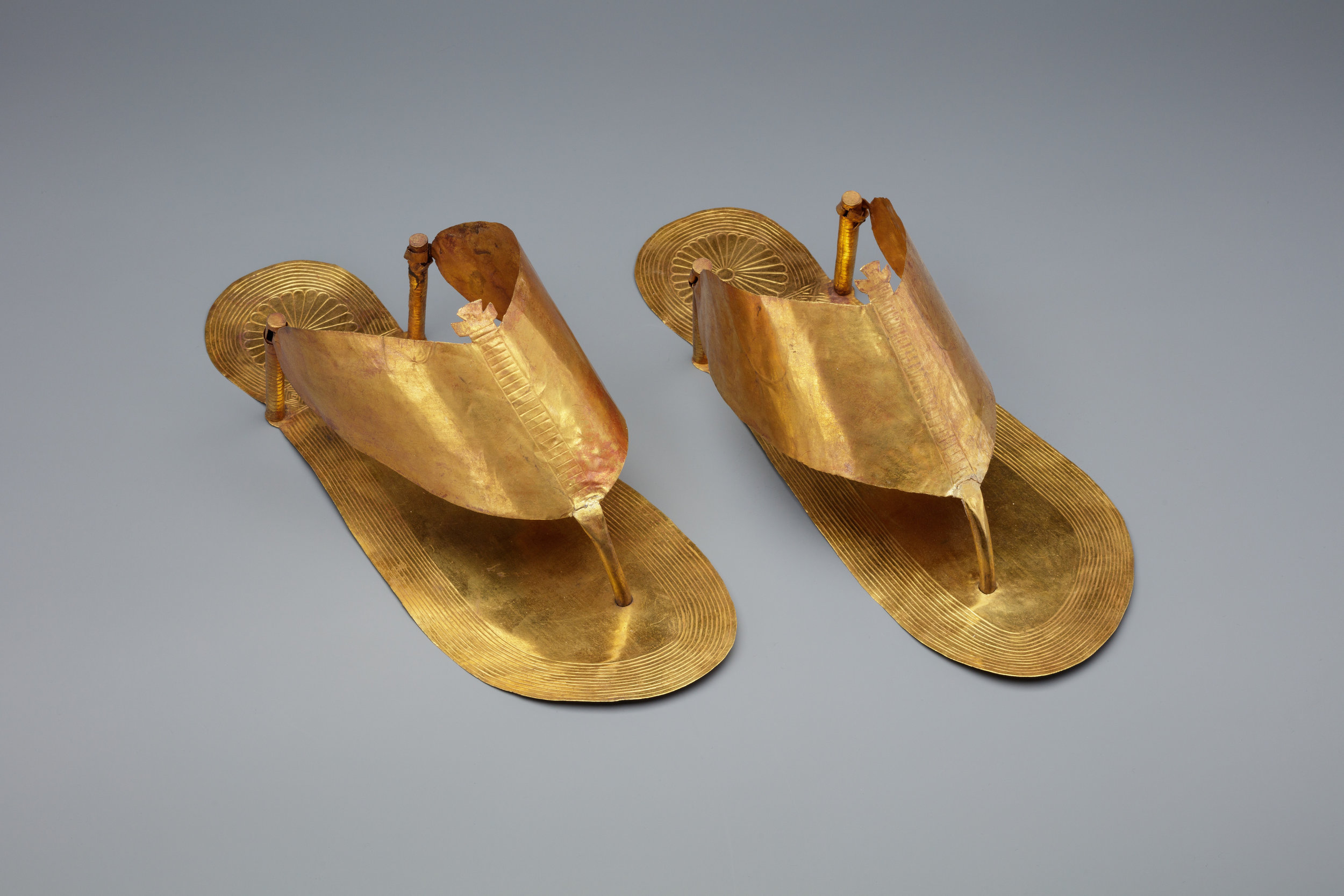 let's slip into our golden shoes and go about our business. - Gold sandles ca. 1479–1425 B.C., which probably weren't meant for everyday wear. Courtesy of the Metropolitan Museum of Art.
