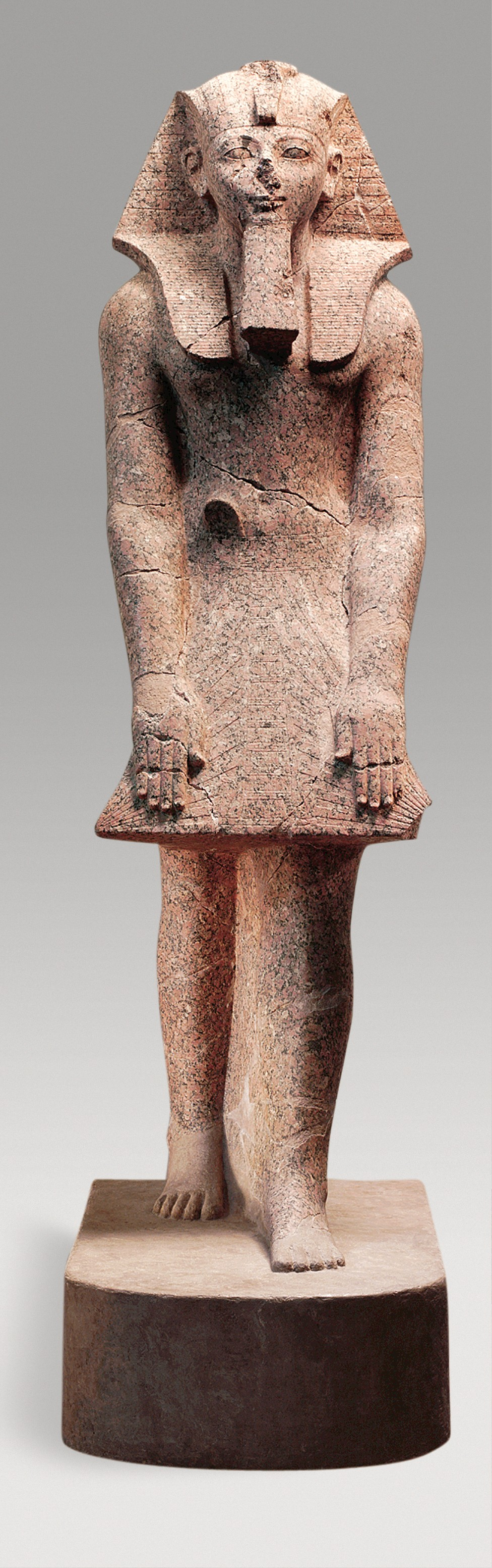Here we see Hatshepsut in transition: she's got a few womanly curves, but is also wear full king clothes: a kilt, the royal kingly headdress, and an amazingly sculpted beard.   Courtesy of the Metropolitan Museum of Art